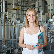 Female student standing in a chemistry lab