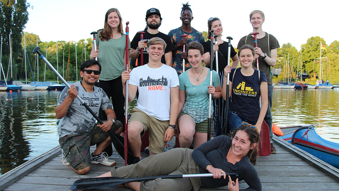 Group of students with canoe oars