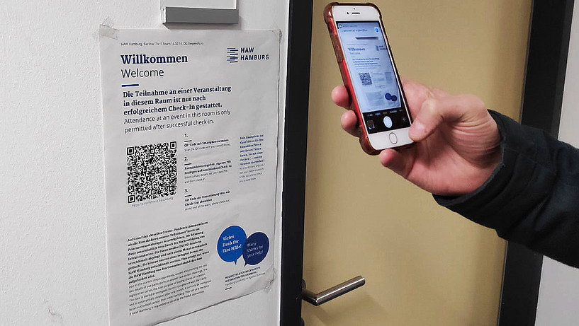 A QR code is scanned with a smartphone.