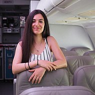 Female student standing in cabin of aircraft