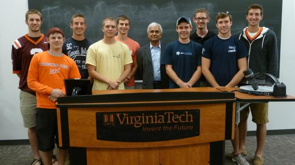 Group of students with professor in a classroom