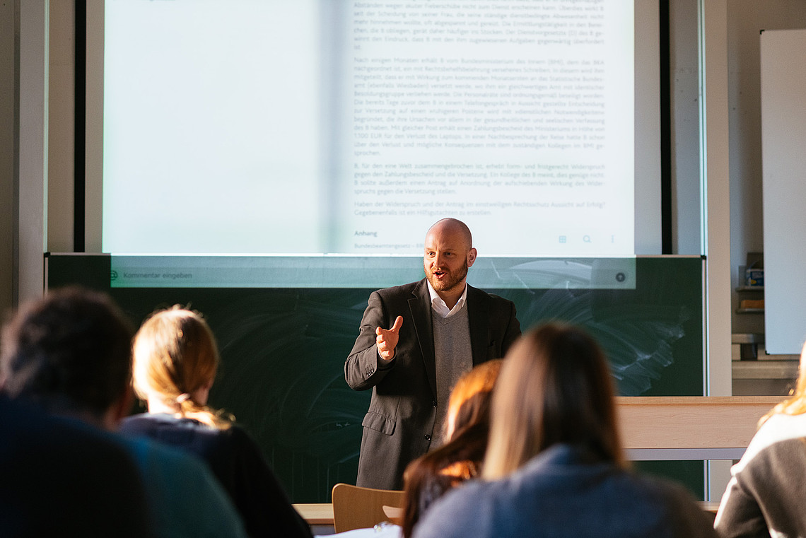 Public Management students in a course taught by instructor Stephan Weiland.
